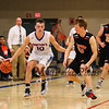 Winnacunnet's #10 Freddy Schaake makes a break up the court with Blackbirds #23 Logan Galanes defending and Keene's Coach Kevin Ritter looking on during Tuesday's NHIAA DIV I Boys Basketball game between Winnacunnet and Keene High Schools on 12-20-2015 @ WHS.  Matt Parker Photos