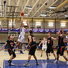 Winnacunnet's #11 Liam Viviano makes a jump shot from the top of the key with Blackbirds #40 Owen Fauth and #33 Jake Blaisdell and others looking on during Tuesday's NHIAA DIV I Boys Basketball game between Winnacunnet and Keene High Schools on 12-20-2015 @ WHS.  Matt Parker Photos
