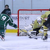 Clippers Goal Keeper #31 Brad Weit makes a save on a shot by Dover's #9 Jameson Goodridge with Clippers #11 Luke Squire covering during Wednesday's Hockey Game between Portsmouth-Newmarket and Dover High Schools on 12-21-2016 @ The Rinks at Exeter.  Matt Parker Photos