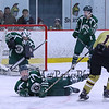 Clippers #11 Luke Squire's shot is deflected by Dover Goal Keeper #33 Colby Stewart with Dover's #22 Jared Turgeon defending  during Wednesday's Hockey Game between Portsmouth-Newmarket and Dover High Schools on 12-21-2016 @ The Rinks at Exeter.  Matt Parker Photos