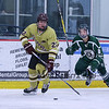 Clippers #22 Jacob Morin looks for an open player with Dover's #8 Andrew Madden trailing during Wednesday's Hockey Game between Portsmouth-Newmarket and Dover High Schools on 12-21-2016 @ The Rinks at Exeter.  Matt Parker Photos