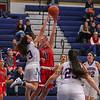 Winnacunnet's #3 Hannah Driscoll blocks a shot by Memorial's #11 Ashley Mathieu-Lafrance during Thursday's NHIAA DIV I Girls Basketball Game between Winnacunnet and Memorial high Schools on 12-22-2016 @ WHS.  Matt Parker Photos