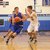 Winnacunnet's #21 Logan Keene drives to the hoop with Marshwood's #24 John Doherty defending during Tuesday's Semi-final game between Winnacunnet and Marshwood High Schools at the Bobcat Invitational Basketball Tournament on 12-27-2016 @ Oyster River HS.  Matt Parker Photos