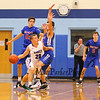 Marshwood's #20  Sam Auguier gets double-teamed by Winnacunnet's #12 John Cadagan and #10 Freddy Schaake during Tuesday's Semi-final game between Winnacunnet and Marshwood High Schools at the Bobcat Invitational Basketball Tournament on 12-27-2016 @ Oyster River HS.  Matt Parker Photos