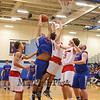 Winnacunnet's #24 Seth Provencher grabs a rebound over Spaulding's #23 Vernon Carmack during Wednesday's Championship game at the  2016 Oyster River High School Bobcat Invitational Boys Basketball Tournament on 12-28-2016 @ Oyster River HS.  Matt Parker Photos