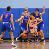 Spaulding's #20 Jean-Paul Paradis dribbles the ball out of a double-team by Winnacunnet's #10 Freddy Schaake and #23 Ben Allen during Wednesday's Championship game at the  2016 Oyster River High School Bobcat Invitational Boys Basketball Tournament on 12-28-2016 @ Oyster River HS.  Matt Parker Photos