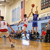 Winnacunnet's #5 Zach Waterhouse takes and makes a 3-pointer with Spaulding's #13 Isiah Rose jumping to get a hand up during Wednesday's Championship game at the  2016 Oyster River High School Bobcat Invitational Boys Basketball Tournament on 12-28-2016 @ Oyster River HS.  Matt Parker Photos