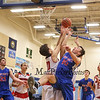 Winnacunnet's #10 Freddy Schaake goes up for a rebound against Spaulding's #20 Jean-Paul Paradis and #25 Matt Roy during Wednesday's Championship game at the  2016 Oyster River High School Bobcat Invitational Boys Basketball Tournament on 12-28-2016 @ Oyster River HS.  Matt Parker Photos
