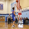 Spaulding's #5 Arie Breakfield takes a 3-pointer with Winnacunnet's #23 Ben Allen stepping in to defend during Wednesday's Championship game at the  2016 Oyster River High School Bobcat Invitational Boys Basketball Tournament on 12-28-2016 @ Oyster River HS.  Matt Parker Photos