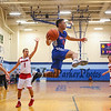 Winnacunnet's #11 Liam Viviano jumps to save the ball from going out of bounds during Wednesday's Championship game at the  2016 Oyster River High School Bobcat Invitational Boys Basketball Tournament on 12-28-2016 @ Oyster River HS.  Matt Parker Photos
