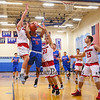 Winnacunnet's #11 Liam Viviano goes up for a shot and gets fouled by Spaulding's #5 Arie Breakfield with #20 Jean-Paul Paradis helping during Wednesday's Championship game at the  2016 Oyster River High School Bobcat Invitational Boys Basketball Tournament on 12-28-2016 @ Oyster River HS.  Matt Parker Photos