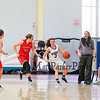 Winnacunnet's #3 Hannah Driscoll gets pressure from Central Catholic's #45 Katie Kirsch with Winnacunnet's Coach Cassie Turcotte giving instructions during Wednesday's Girls Basketball Game at the 2016 Commonwealth Christmas Classic Tournament between Winnacunnet and Central Catholic High Schools on 12-28-2016 @ North Andover High School, N. Andover, MA.  Matt Parker Photos