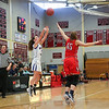 Winnacunnet's #3 Hannah Driscoll takes a 3-pointer with Central Catholic's #45 Katie Kirsch putting a hand up to defend during Wednesday's Girls Basketball Game at the 2016 Commonwealth Christmas Classic Tournament between Winnacunnet and Central Catholic High Schools on 12-28-2016 @ North Andover High School, N. Andover, MA.  Matt Parker Photos