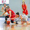 Central Catholics #2 Nicole Wiggins and Winnacunnet's #22 Emily Britton reach for a loose ball during Wednesday's Girls Basketball Game at the 2016 Commonwealth Christmas Classic Tournament between Winnacunnet and Central Catholic High Schools on 12-28-2016 @ North Andover High School, N. Andover, MA.  Matt Parker Photos