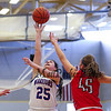 Winnacunnet's #25 Ashley Aversano takes a shot with Central Catholics #45 Katie Kirsch and #3 Maura Smith defending during Wednesday's Girls Basketball Game at the 2016 Commonwealth Christmas Classic Tournament between Winnacunnet and Central Catholic High Schools on 12-28-2016 @ North Andover High School, N. Andover, MA.  Matt Parker Photos