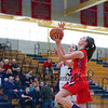 Central Catholic's #10 Nicole Elbeery goes in for a layup with Winnacunnet's #3 Hannah Driscoll looking to block the ball during Wednesday's Girls Basketball Game at the 2016 Commonwealth Christmas Classic Tournament between Winnacunnet and Central Catholic High Schools on 12-28-2016 @ North Andover High School, N. Andover, MA.  Matt Parker Photos