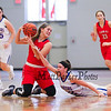 Central Catholics #2 Nicole Wiggins keeps control of a loose ball with Winnacunnet's #22 Emily Britton looking to take possession during Wednesday's Girls Basketball Game at the 2016 Commonwealth Christmas Classic Tournament between Winnacunnet and Central Catholic High Schools on 12-28-2016 @ North Andover High School, N. Andover, MA.  Matt Parker Photos