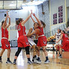 Winnacunnet's #23 Kaya Cadagan gets trapped by Central Catholics #45 Katie Kirsch and #3 Maura Smith during Wednesday's Girls Basketball Game at the 2016 Commonwealth Christmas Classic Tournament between Winnacunnet and Central Catholic High Schools on 12-28-2016 @ North Andover High School, N. Andover, MA.  Matt Parker Photos