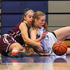 Winnacunnet's Freshman Guard #5 Ashley Gallant and Alvirne's #4 Emily Lizotte wrestle for a loose ball during Friday's NHIAA DIV I Home opener between Winnacunnet and Alvirne High Schools on 12-9-2016 @ WHS.  Matt Parker Photos