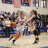 Winnacunnet's #14 Meg Knollmeyer makes a cut to the hoop past Exeter's #45 Emily Raynowka during Thursday's NHIAA DIV I Girls Basketball game between Winnacunnet and Exeter High Schools on 2-11-2016 @ WHS.  Matt Parker Photos