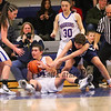 Winnacunnet's #14 Meg Knollmeyer heads to the floor to grab a loose ball with Exeter's #25 Charlotte Camp during Thursday's NHIAA DIV I Girls Basketball game between Winnacunnet and Exeter High Schools on 2-11-2016 @ WHS.  Matt Parker Photos