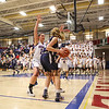 Winnacunnet's #14 Meg Knollmeyer traps Exeter's #30 Anna Pafford in the corner during Thursday's NHIAA DIV I Girls Basketball game between Winnacunnet and Exeter High Schools on 2-11-2016 @ WHS.  Matt Parker Photos