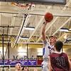 Winnacunnet's #5 Zach Waterhouse puts the ball off the glass for a basket during Tuesday's NHIAA DIV I Basketball game between Winnacunnet and Alvirne High Schools on 2-23-2016 @ WHS.  Matt Parker Photos