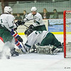 Winnacunnet's #5 Aaron Garrison scores off a deflected Conor Allyn shot as Kingswood's Goalie #30 Alex McKenna dives to make a save during Wednesday Night's NHIAA Div II Boys Hockey game between Winnacunnet and Kingswood High School @ Pop Whalen Ice Arena, Wolfeboro, NH on 2-3-2016.  Matt Parker Photos