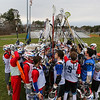 Winnacunnet Warriors Boys Lacrosse players make a stick tower in a team huddle after Wednesday's practice on 3-23-2016 @ WHS.  Matt Parker Photos