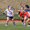 Winnacunnet's Meg Dzialo gets pressure from Woburn players  during Wednesday's Girls Lacrosse preseason scrimmage vs Woburn Memorial DIV I High School on 3-30-2016 @ WHS.  Matt Parker Photos