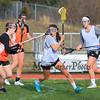 Winnacunnet's Kelly Arsenault looks for an opening during Wednesday's Girls Lacrosse preseason scrimmage vs Woburn Memorial DIV I High School on 3-30-2016 @ WHS.  Matt Parker Photos