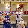 Winnacunnet's #11 Anthony Primavera drives to the hoop for a layup with defense from Lancers #00 Cameron Reedy during Wednesday's 1st Round NHIAA DIV I Boys Basketball playoff game between #7 Winnacunnet and #10 Londonderry High Schools on 3-9-2016 @ WHS.  Matt Parker Photos