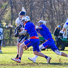 St. Thomas's #25 Liam Middleton takes a shot on the WHS goal with Winnacunnet's #81 Gabe Paster defending during Wednesday's NHIAA DIV II Boys Lacrosse game vs Winnacunnet and St. Thomas Aquinas High Schools @ STA on 4-13-2016.  Matt Parker Photos