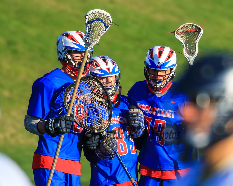Winnacunnet's Goal Keeper #83 Matt Cooney is congratualted by teammates #79 Mike Palazollo and #81 Gabe Paster after winning Wednesday's NHIAA DIV II Boys Lacrosse game vs Winnacunnet and St. Thomas Aquinas High Schools @ STA on 4-13-2016.  Matt Parker Photos