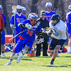 Winnacunnet's #76 Brian Auffant looks up field for an open player as STA's #13 Sam Andolina applies pressure during Wednesday's NHIAA DIV II Boys Lacrosse game vs Winnacunnet and St. Thomas Aquinas High Schools @ STA on 4-13-2016.  Matt Parker Photos