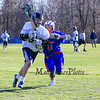 St. Thomas's #31 Tom Bouchard makes a break up the sidelines with Winnacunnet's #91 Darren Gibadlo looking to force him out of bounds during Wednesday's NHIAA DIV II Boys Lacrosse game vs Winnacunnet and St. Thomas Aquinas High Schools @ STA on 4-13-2016.  Matt Parker Photos