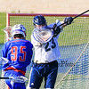 St. Thomas's Goal Keeper #23 Jay Gallipo is able to deflect a shot by Winnacunnet's #95 Jack Rademacher during Wednesday's NHIAA DIV II Boys Lacrosse game vs Winnacunnet and St. Thomas Aquinas High Schools @ STA on 4-13-2016.  Matt Parker Photos