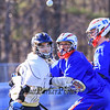 St. Thomas's #16 Garret Downs and Winnacunnet's #80 Morgan McGirl keep their eyes on the ball during Wednesday's NHIAA DIV II Boys Lacrosse game vs Winnacunnet and St. Thomas Aquinas High Schools @ STA on 4-13-2016.  Matt Parker Photos