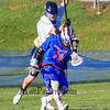 Winnacunnet's #76 Brian Auffant blocks a check by STA's #19 Andrew Geppert as he maintains control of the ball during Wednesday's NHIAA DIV II Boys Lacrosse game vs Winnacunnet and St. Thomas Aquinas High Schools @ STA on 4-13-2016.  Matt Parker Photos