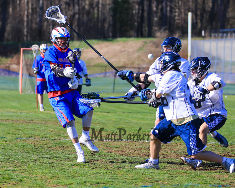 Winnacunnet's #76 Brian Auffant takes a shot on the St. Thomas goal with STA players covering to defend during Wednesday's NHIAA DIV II Boys Lacrosse game vs Winnacunnet and St. Thomas Aquinas High Schools @ STA on 4-13-2016.  Matt Parker Photos