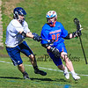Winnacunnet's #89 Lucas Sexton cuts around the back of the St. Thomas goal with STA's #14 Matt Savage defending during Wednesday's NHIAA DIV II Boys Lacrosse game vs Winnacunnet and St. Thomas Aquinas High Schools @ STA on 4-13-2016.  Matt Parker Photos