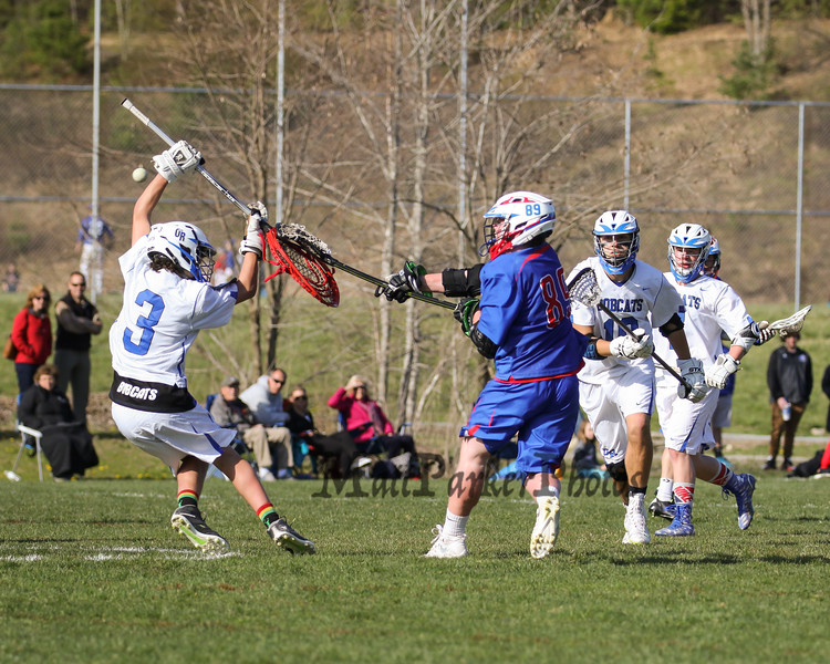 Winnacunnet's #89 Lucas Sexton shoots the ball past Bobcat Goal Keeper #3 Will Cilia during Friday's NHIAA DIV II Boys Lacrosse game between Winnacunnet and Oyster River High School on 4-29-2016 @ Little River Field, Lee, NH.  Matt Parker Photos