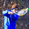 Winnacunnet Junior Sam Cranford returns the ball at Tuesday's practice in place of their first scheduled away meet at Londonderry which was cancelled due to a Monday snow storm that blanketed New Hampshire 4-5-2016 @ WHS.  Matt Parker Photos