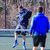 Winnacunnet's Robert Lamprey returns a net shot to Ryan Gallant during a net play drill at Tuesday's practice in place of their first scheduled away meet at Londonderry which was cancelled due to a Monday snow storm that blanketed New Hampshire 4-5-2016 @ WHS.  Matt Parker Photos