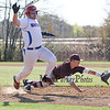 Winnacunnet's #9 Jeff Biron makes is safely to 1st after a low throw to Timberlanes' 1st Baseman #8 xxxx during Wednesday's NHIAA DIV I Boys Baseball game between Winnacunnet and Timberlane High Schools on 5-11-2016.  Matt Parker Photos
