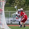 Winnacunnet's #89 Lucas Sexton shoots and scores with Spaulding's #22 Jonah Hunt and Goal Keeper #25 Jory Hall defending during Tuesday's NHIAA DIV II Boys Lacrosse game between Winnacunnet and Spaulding High Schools on 5-24-2016.  Matt Parker Photos