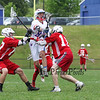 Winnacunnet's #87 Max Dunham is able to take a shot despite heavy pressure from Spaulding's #27 Conner Breeze, #10 Marcus Myckoff and #4  Andrew Lucas defending during Tuesday's NHIAA DIV II Boys Lacrosse game between Winnacunnet and Spaulding High Schools on 5-24-2016.  Matt Parker Photos