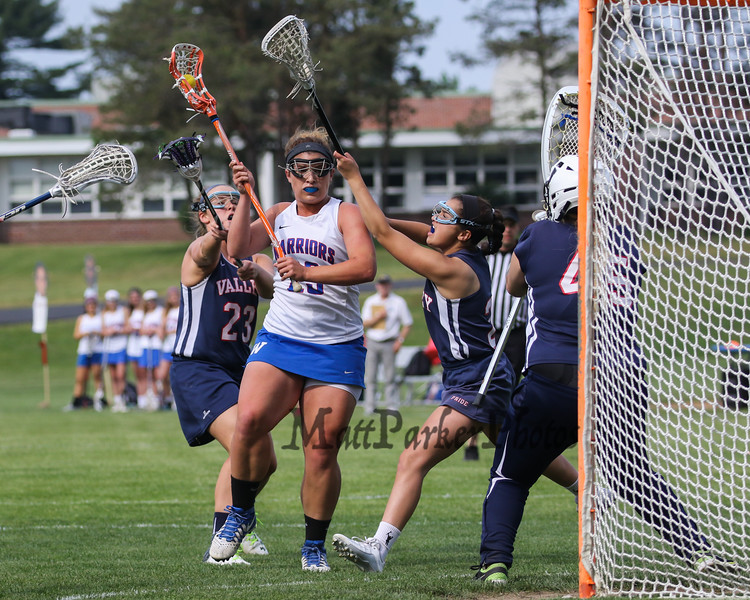 Winnacunnet's #23 Alia Strukel makes a move to the net with Pride's #23 Abby Grandmaison and #3 Izzy Hoyt covering and Goal Keeper Brittany Leonard covering the net during Thursday's NHIAA DIV II Girls Lacrosse game between Winnacunnet and Merrimack Valley on 5-26-2016 @ WHS.  Matt Parker Photos