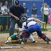 Winnacunnet's Catcher #1 Bailey Faulkingham swings her glove into the leg of BG baserunner #11 Kim Macia but is unable to make the tag during Thursday's NHIAA DIV I Girls Softball game between Winnacunnet and Bishop Guertin  on 5-26-2016 @ WHS.  Matt Parker Photos