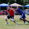 Portsmouth's Will Conner makes a catch with a Methuen player covering during Saturday's 7v7 Under Armour Football Tournament vs Methuen MA on 7-16-2016 @ Exeter High School.  Matt Parker Photos